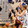 Don Knight |  The Herald Bulletin<br /> Alexandria's Allison Aiman looks to shoot as she is guarded by Lapel's Makynlee Taylor and Breanna Boles as the Bulldogs hosted the Tigers on Wednesday.