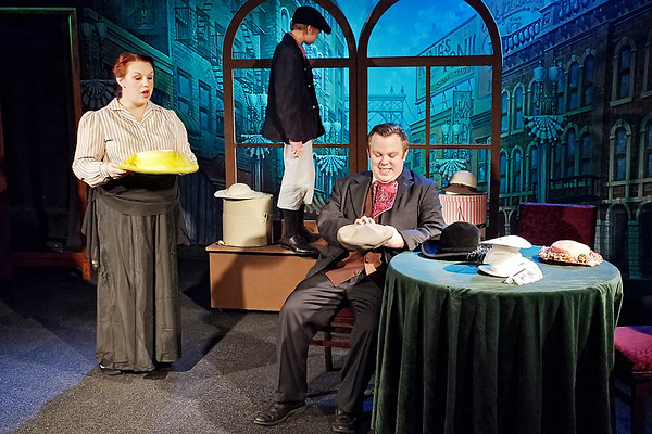 Mark Maynard | for The Herald Bulletin<br /> Milliner Mrs. Irene Molloy (Tiffany Jackson) shows Cornelius Hackl (Cameron Vale) her wares, while Barnaby Tucker (Garrett Bonesteel) keeps a lookout .