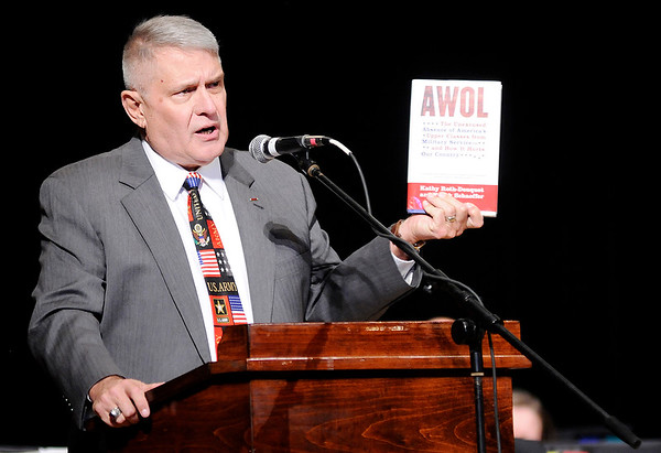 "Don Knight |  The Herald Bulletin<br /> Retired Command Master Sergeant Stephen W. Short cites the 2006 book ""AWOL: The Absence of America's Upper Classes From Military Service and How It Hurts our Country,"" during the Madison County Veterans Day Celebration at the Paramount on Thursday."
