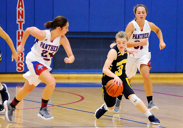 Don Knight   The Herald Bulletin<br /> Shenandoah's Kathryn Peery cuts back between Elwood's Caroline Daughtry (24) and Ashley Titley as she brings the ball down court for the Raiders as they faced the Panthers on Thursday.