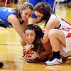 John P. Cleary |  The Herald Bulletin<br /> Liberty Christian's Karli Petty, middle, holds on to the ball as Southern Wells Kirtlyn Noble, and Liberty Christian's Kennedy Fillmore also fight for the loose ball.
