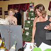 Mark Maynard | for The Herald Bulletin<br /> Shelly Ricker and Jennifer Sargent check out the Christmas items up for auction during the Festival of the Trees Gala at Anderson's Paramount Theatre.