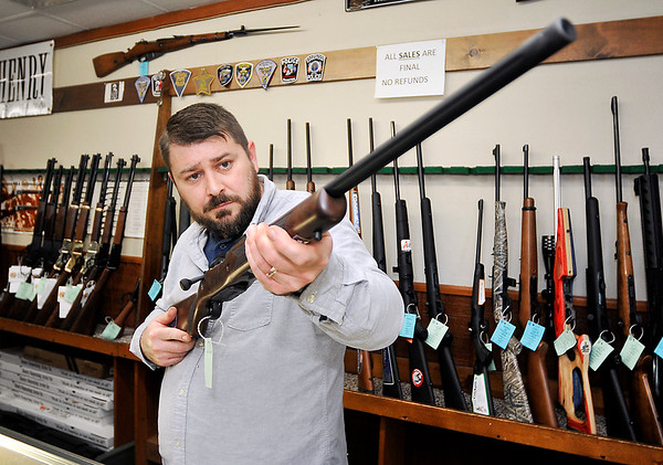 John P. Cleary |  The Herald Bulletin<br /> Joe Key, deer hunter and owner of Crack Shot Guns in Anderson, checks out this Mossberg Patriot 270 caliber rifle in his store this past week.