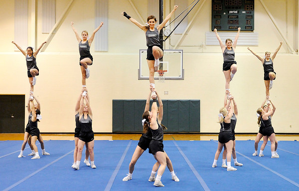 Don Knight |  The Herald Bulletin<br /> The Pendleton Heights cheerleaders practice on Thursday.