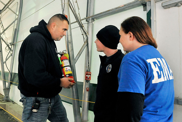 John P. Cleary |  The Herald Bulletin<br /> Rick Rogers, Markleville-Adams Twp. firefighter, shows Madison County Emergency Management Agency cadets Jacob Harmeson and Marra Widener the placement of fire extinguishers as they toured Indy Scream Park earlier this week to learn about public safety and security at the facility.