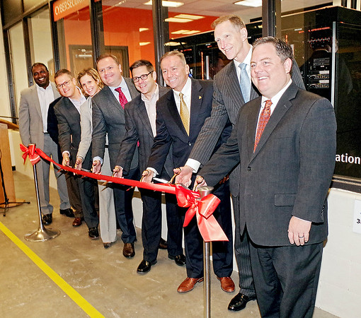 Mark Maynard   for The Herald Bulletin<br /> Bala Karapatti (Dell EMC), Matthew Grashoff (Extreme Networks, Inc.), Anne Teel, David Raftery (Integration Partners), Eric Miller (Ascension Information Services), Gerry Lewis (Ascension Information Services), President John Pistole and Dean Chad Wallace prepare to cut the ribbon officially opening Anderson University's new Cybersecurity Engineering Laboratory.