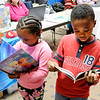 Don Knight | The Herald Bulletin<br /> From left, Zamyah and Zaire White look at books they picked up from the Head Start booth during the Family Health and Education Night at the Anderson Public Library on Wednesday.