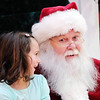 Don Knight |  The Herald Bulletin<br /> Tinsley Crider, 6, tells Santa that she wants a baby doll and a Barbie as Santa arrived at Mounds Mall on Friday. Santa will be at the mall from 5 - 8pm Monday through Friday and noon to 8pm on Saturdays and 1 to 5pm on Sundays. The week before Christmas he'll have special hours starting on the 18th from noon to 8pm daily and 11am - 5pm on Christmas Eve.