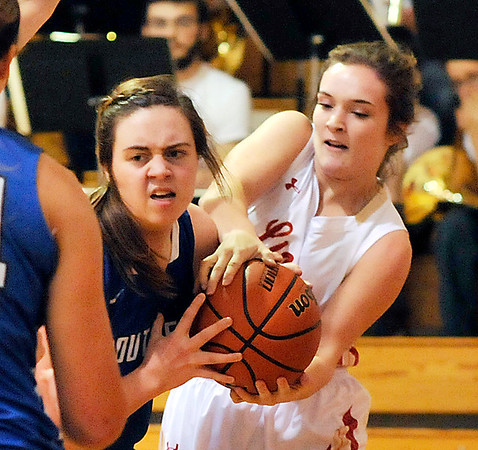 John P. Cleary |  The Herald Bulletin<br /> Southern Wells Sarah Bothast gets tied up by Liberty Christian's Kennedy Fillmore.