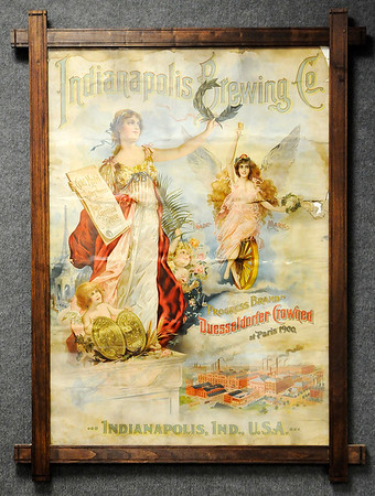 "Don Knight |  The Herald Bulletin<br /> A poster from the Indianapolis Brewing Company is part of the ""History of Brewing, Distilling and Bottling in Indiana"" exhibit at the Madison County Historical Society."