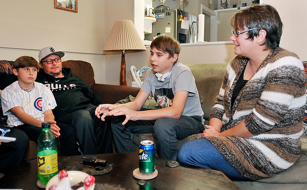 John P. Cleary |  The Herald Bulletin<br /> Lapel freshman Paden Hudson,14, center, is glad to back home with his family, brother Rylie, 11, and parents Kevin and Jaime Hudson, after spending months in Peyton Manning Chidren's Hospital in Indianapolis battling a septic MRSA attack.