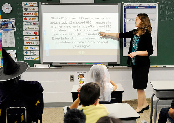 Don Knight    The Herald Bulletin<br /> Kim Gibson goes over a math question with her third grade students at the Indiana Christian Academy on Wednesday.