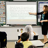 Don Knight |  The Herald Bulletin<br /> Kim Gibson goes over a math question with her third grade students at the Indiana Christian Academy on Wednesday.
