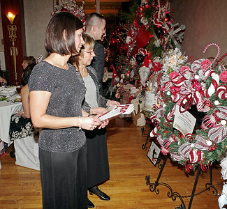 Mark Maynard | for The Herald Bulletin Madison Circuit Court Judge Angela Warner-Sims and her mother, Mary Ann Warner, look over Christmas wreaths up for auction during the Festival of the Trees Gala at the Paramount Theatre.