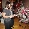 Mark Maynard | for The Herald Bulletin<br /> Madison Circuit Court Judge Angela Warner-Sims and her mother, Mary Ann Warner, look over Christmas wreaths up for auction during the Festival of the Trees Gala at the Paramount Theatre.