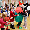 Don Knight |  The Herald Bulletin<br /> Dressed as an elf, Judy Lippman leads a dance train during Breakfast with Santa at the Paramount on Saturday.