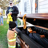 John P. Cleary |  The Herald Bulletin<br /> Mason Eggenberg, 2, reacts to the body in the coffin as he goes up to Larry Triplett's house to trick-or-treat at 121 Mohawk Street in North Anderson.