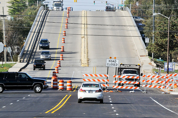 John P. Cleary    The Herald Bulletin<br /> Barriers went up Tuesday closing the westbound lanes of Eisenhower Bridge with restrictions to eastbound traffic to one lane over the structure in preparation of work starting next week to rebuild the structure.