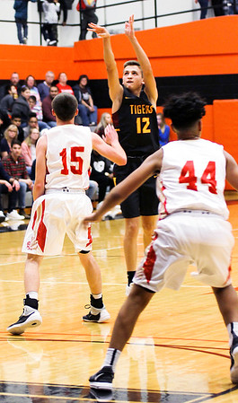 Chris Martin for The Herald Bulletin<br /> Alexandria's Sam Hensley shoots a three against Liberty Christian Saturday night at Anderson University