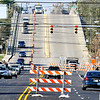 John P. Cleary |  The Herald Bulletin<br /> Barriers went up Tuesday closing the westbound lanes of Eisenhower Bridge with restrictions to eastbound traffic to one lane over the structure in preparation of work starting next week to rebuild the structure.