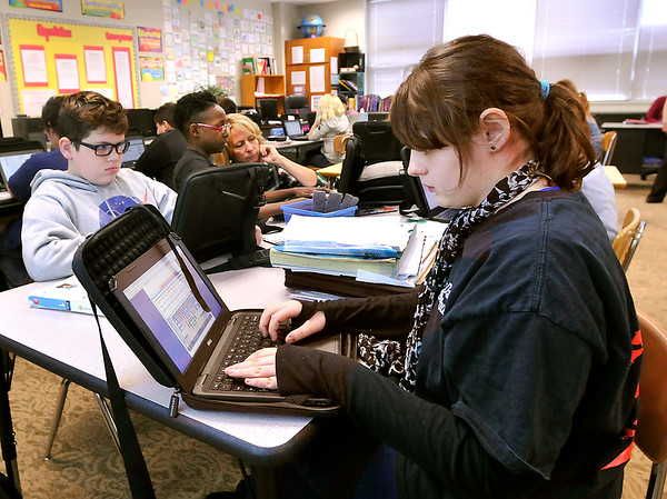 John P. Cleary |  The Herald Bulletin<br /> Highland Middle School sixth-grader Hayleigh Crafton works on her laptop in Jane Freeman's class.