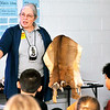 John P. Cleary |  The Herald Bulletin<br /> Dani Tippmann, a member of the Miami tribe, tells the students in Megan Nolan's third and fourth-grade high ability class at Alexandria-Monroe Intermediate School about this deer pelt and what you might tell about the animal by its skin during a presentation this past Thursday.