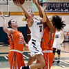 John P. Cleary | The Herald Bulletin<br /> Pendleton Heights Kylie Davis goes up and shoots between Hamilton Heights defenders Lauryn Wiley and Mykayla Moran.