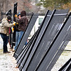 John P. Cleary | The Herald Bulletin<br /> Workers from Mofab Inc. start to set and weld up sections of the new iron fencing that runs along the entrance to Maplewood Cemetery on College Ave. Tuesday afternoon. The old iron fence was torn out and is now being replaced by this new ironworks.