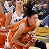 John P. Cleary | The Herald Bulletin<br /> Pendleton Heights Aubree Dwiggins reaches around to try to tie up Hamilton Heights Abby Christiansen.
