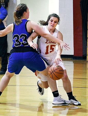 John P. Cleary | The Herald Bulletin<br /> Liberty Christian's Kennedy Fillmore drives the baseline against Irvington's Campbell Wagner.