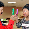 John P. Cleary | The Herald Bulletin<br /> Kailani McCloud, 13, aka Mr. Green, and Nani McCloud, 11, aka Miss Scarlett, prepare to test their detective skills as they play Life Size Clue at the Anderson Public Library Monday evening.
