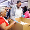 Don Knight | The Herald Bulletin<br /> Daniel Baxter fills a box with a delivery order during the Gospel Highlight Radio Broadcast Community Thanksgiving Day Dinner at the Geater Center on Thursday.