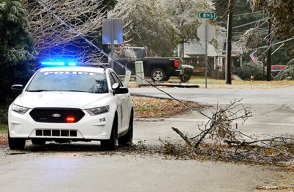 John P. Cleary   The Herald Bulletin<br /> An ice storm hit the area overnight causing power outages throughout Anderson, here Anderson Police block the 700 block of Ellenhust Dr. as a live power line has come down due to falling tree limbs.