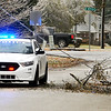 John P. Cleary | The Herald Bulletin<br /> An ice storm hit the area overnight causing power outages throughout Anderson, here Anderson Police block the 700 block of Ellenhust Dr. as a live power line has come down due to falling tree limbs.