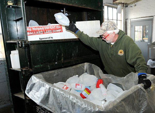 Don Knight   The Herald Bulletin<br /> John Paugh loads plastic into a compactor at the Madison County Recycling Center on Thursday.