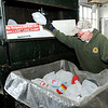 Don Knight | The Herald Bulletin<br /> John Paugh loads plastic into a compactor at the Madison County Recycling Center on Thursday.