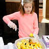 Don Knight | The Herald Bulletin<br /> Kennedi Buck, 8, serves fruit salad during the The Christian Center Thanksgiving meal at the Knights of Columbus on Thursday.