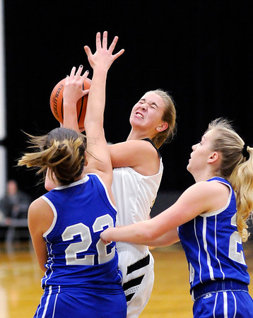 Don Knight | The Herald Bulletin<br /> Daleville's Heather Pautler draws a foul from APA's Olivia Alderman on a drive to the basket as the Broncos hosted the Jets Saturday.