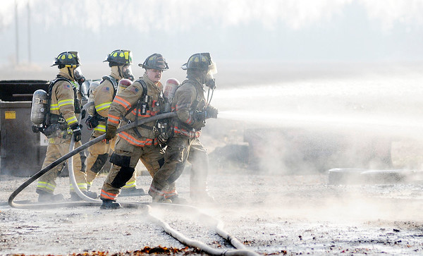 Don Knight   The Herald Bulletin<br /> Fire fighters battle a barn fire on County Road 500 South on Thursday.