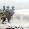 Don Knight | The Herald Bulletin<br /> Fire fighters battle a barn fire on County Road 500 South on Thursday.