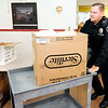 Don Knight | The Herald Bulletin<br /> Anderson Police Department Officer Brett Webb delivers meals during the Gospel Highlight Radio Broadcast Community Thanksgiving Day Dinner at the Geater Center on Thursday.