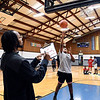 John P. Cleary | The Herald Bulletin<br /> Scorekeeper Olajuwon Broome keeps count as Jay'lin Barnes, 12, shoots the ball in the speed lay-up contest at the Parks and Recreation Department's 2018 Turkey Shoot Out at the Geater Center Wednesday. Barnes places second after an overtime shootout with winner Dontrez Fuller, 12.