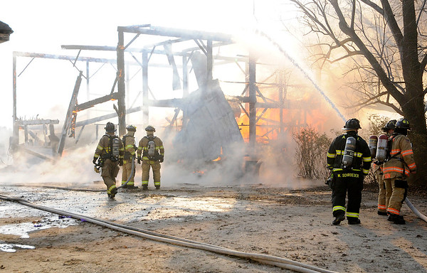 Don Knight | The Herald Bulletin<br /> Fire destroyed a 120 year old barn on County Road 500 South on Thursday.