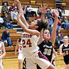 John P. Cleary | The Herald Bulletin<br /> Alexandria's Jenna Reece VanBlair lets go a shot as she drives around Daleville defender Audrey Voss.