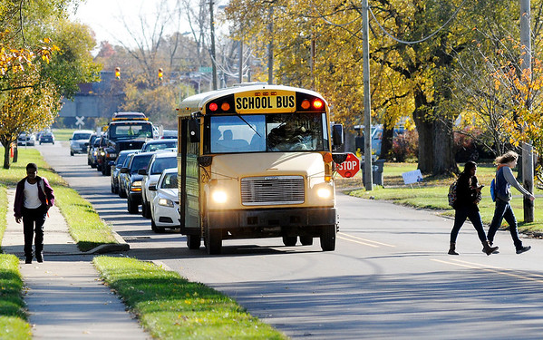 Don Knight | The Herald Bulletin<br /> Students disembark from their school bus on Madison Avenue on Wednesday. Possible changes to Indiana law regarding school bus safety include cameras on the stopping arm and making passing a school bus a misdemeanor crime.