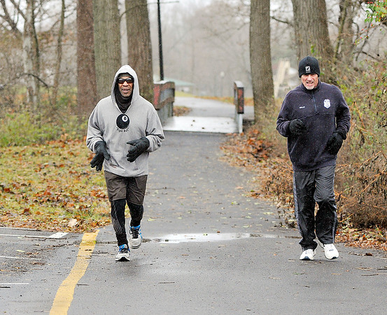 John P. Cleary   The Herald Bulletin<br /> It was a cold, blustery day for a jog but that didn't bother these two as they made their way around Shadyside Park Monday afternoon getting in their run.