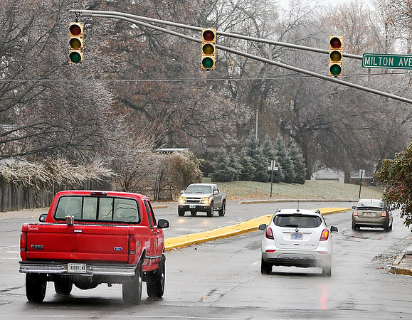 John P. Cleary   The Herald Bulletin<br /> Due to a overnight ice storm many stop lights were out due to power outages around Anderson. Here the lights at Milton Ave. and University Blvd. were out with drivers treating it as a 4-way stop.