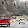John P. Cleary | The Herald Bulletin<br /> Due to a overnight ice storm many stop lights were out due to power outages around Anderson. Here the lights at Milton Ave. and University Blvd. were out with drivers treating it as a 4-way stop.