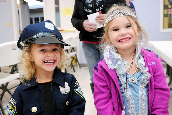Don Knight | The Herald Bulletin<br /> Lucy Hunt dressed as a police officer and Faithe Lemon dressed as Cinderella as they visited the Trunk-n-Treat at First Baptist Church in Anderson on Tuesday.