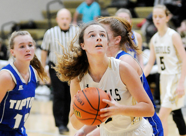 Don Knight | The Herald Bulletin Madison-Grant's Zoey Barnett looks to shoot the ball as the Argylls hosted the Tipton Blue Devils on Saturday.